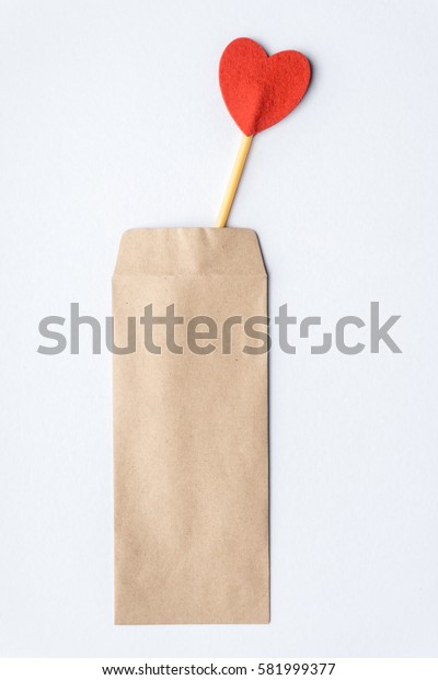 A love stick and brown envelope over white background. Love Concept.
