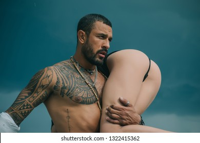 Love story. Beautiful young couple. Love concept. Passion. Romantic moment. Handsome muscular guy and amazing sexy woman