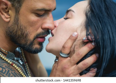 Love story. Beautiful young couple hugging. Love concept. Couple is hugging. Passion love couple. Romantic moment. Muscular man and fit slim young female kissing. Couple goals