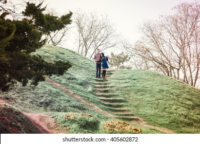 Love story. Beautiful young loving couple embracing in blossom spring garden. Romantic dating. Spring outdoor.