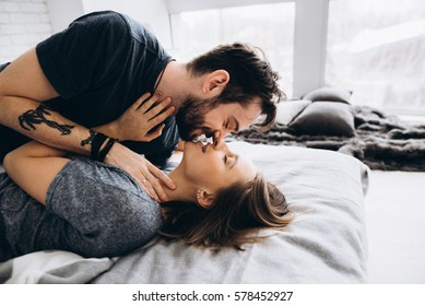 Love tattoo images stock photos vectors shutterstock in love couple hug and kiss on the bed near the window in altavistaventures Gallery