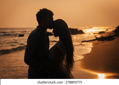 Love story. Couple on the sunset
