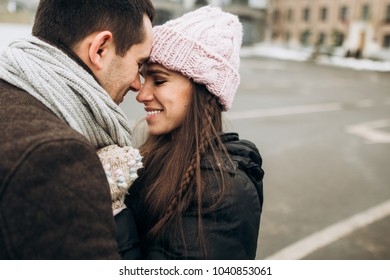 Love story. Happy couple hugging and enjoying each other walking around the city