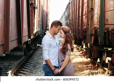 Love story photo on outdoor. Models. Fashion and beauty photo. Couple in love. Pretty girl and brutal guy walking in outdoor