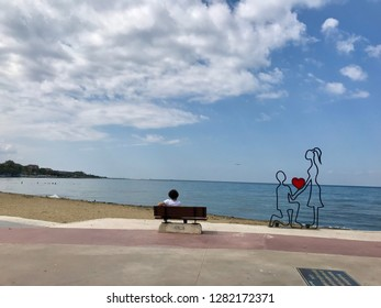 A love street artwork for a man proposing love to a woman on the beach and blue sky - photo was taken in Turkey Yalova city on September 10th, 2019