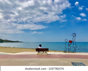 A love street artwork for a man proposing love to a woman on the beach and blue sky - taken in Yalova, Turkey on September 10th, 2019