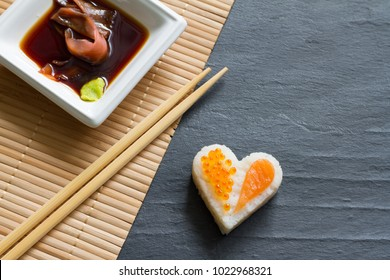 Love sushi abstract menu concept with nigiri heart on black background
