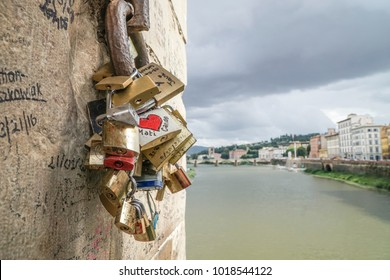 Love symbol padlocks hanged on wall in Italy