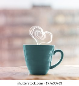 love and tea. heart silhouette from steaming hot cup