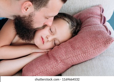 love and tenderness. caring father kissing his daughter goodnight. happy fatherhood and sweet family moments.