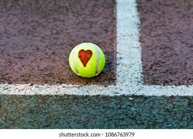 Love tennis - love heart drawn on tennis ball