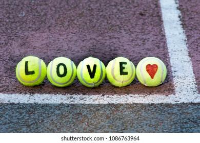 Love tennis - word and heart shape drawn on tennis balls