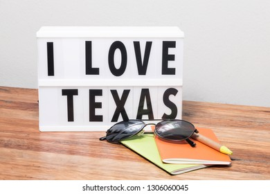 I love Texas lightbox, sunglasses, notebook and pen, travel concept