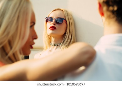 Love triangle concept. Sensual woman look at couple man with girlfriend. Cheating, infidelity, adultery. Jealousy, alluring, desire, romance, love. Date, relations, relationship. twins women