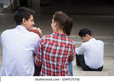 Love triangle. Handsome man jealous for relationship while In love young American couple sweet at stair of modern city. Third guy, uncomfortable situation. loneliness concept