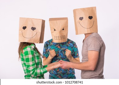 Love triangle, jealousy and unrequited love concept - woman and man with bags over heads holding hands and another man is angry.