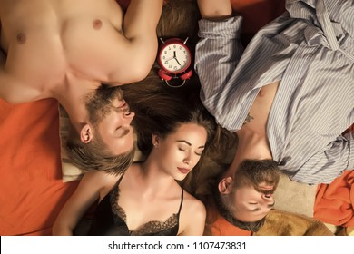 love triangle. people lovers sleep at alarm clock, time. Love triangle and romance, perfect morning. Swinger relations, relax, wake up. men and woman with long hair, lover. Family trust, polygamy