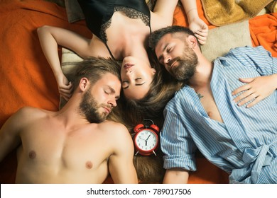 Love triangle and romance, perfect morning. men and woman with long hair, lover. Swinger relations, relax, wake up. Family trust, polygamy, betrayal. people lovers sleep at alarm clock, time. friends