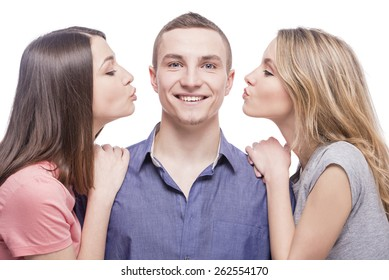 Love triangle. Two young women kissing to the man. isolated on white background.