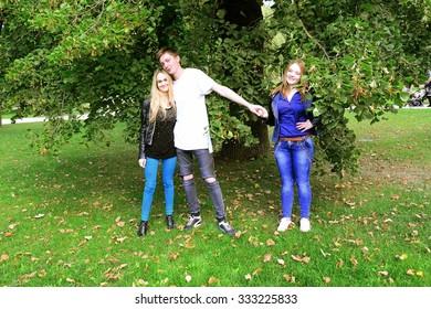 Love triangle in Vilnius town Bernardinu garden on autumn. Lithuania.