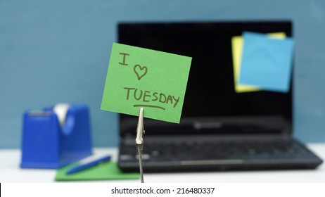 I love tuesday written on a memo at the office
