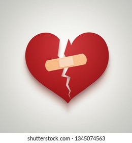 Love, valentines concept, broken paper heart merged with plaster bandage isolated on gray background