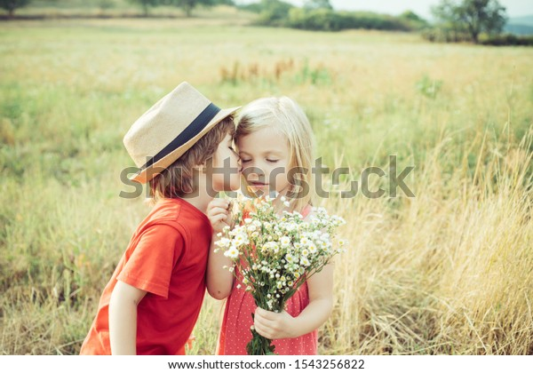 Love. Valentines day. Festive Art Greeting Card. Childhood on countryside. Lovely children. Human emotions - kids first love. Cute little children enjoying at countryside