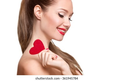Love and valentines day woman holding heart smiling cute. Portrait of Beautiful woman with bright makeup and red heart in hand