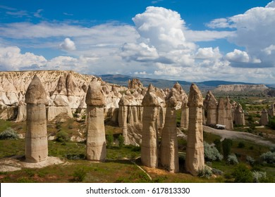 Love valley in Goreme village, Turkey. Rural Cappadocia landscape. Stone houses in Goreme, Cappadocia. Countryside lifestyle.