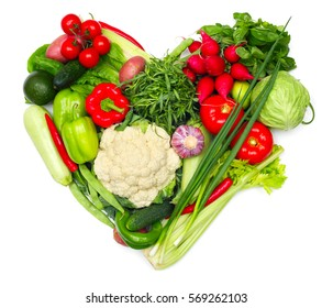 Love vegetables concept, pile of vegetables shaped as heart isolated on white background