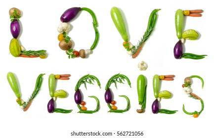 """""""Love veggies"""" written with vegetables as a metaphor or concept for healthy lifestyle, vegetarian or vegan diet, getting fit or reducing calories in meals. Isolated on white background."""