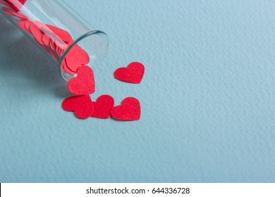 Love in vitro. Cloning and creating children from a test tube. New life from a test tube. Red small hearts poured from the test-tube