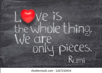 Love is the whole thing -  ancient Persian poet and philosopher Rumi quote written on chalkboard with red heart symbol instead of O