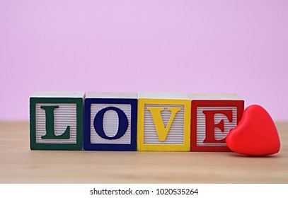 Love wooden word with amazing colors and red heart