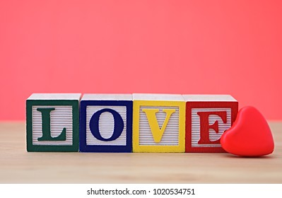 Love wooden word with red heart
