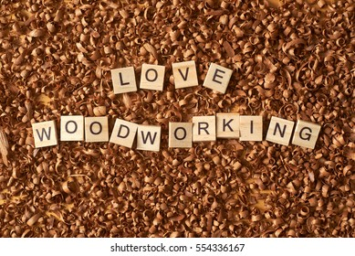 Love woodworking word writen with letters on wood chips