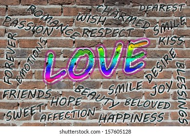 Love word cloud painted with grafitti on a brick wall
