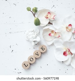 Love word with spring flowers, vintage style background