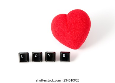 LOVE word written with computer black buttons over white background with a red heart.