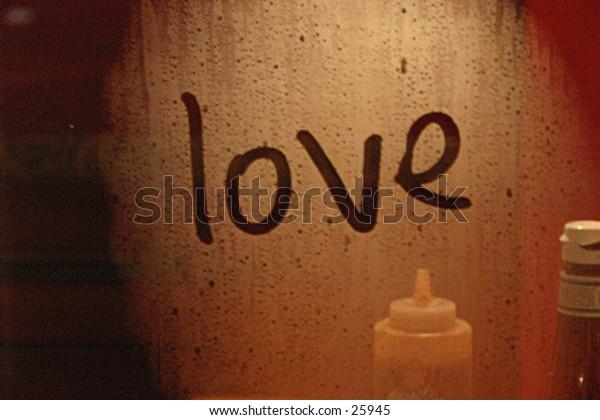 """""""Love"""" writning in a window."""