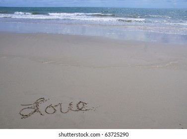 """Love"" written in the sand, room for your text"