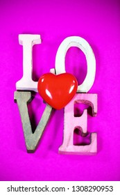 Love, written, text on pink background, valentins day