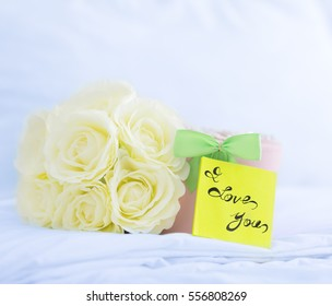I Love You! Beautiful gift box and roses on a bed. LOVE concept.