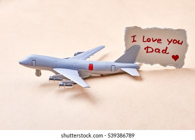 I love you dad card. Toy plane near greeting paper. Child in all of us.