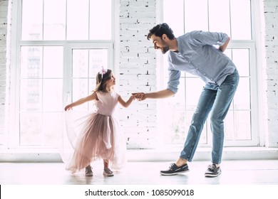 I love you, dad! Handsome young man is dancing at home with his little cute girl. Happy Father's Day! - Shutterstock ID 1085099018