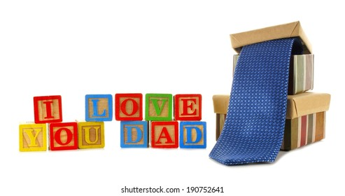 I LOVE YOU DAD toy block letters with gifts isolated on white