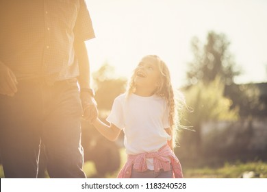 Love you granddad. Granddaughter walking in nature with grandfather. Close up. Copy space.
