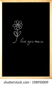 i love you mom is written on a blackboard