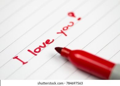 I love you red text written by red crayon on paper. Valentine's Day message