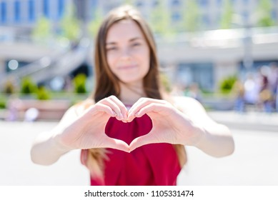 I love you! Send you my heart! Age teen husband wife boyfriend like care dreamy concept. Cropped close up photo portrait of pretty cheerful careless carefree girl shows heart nature city background